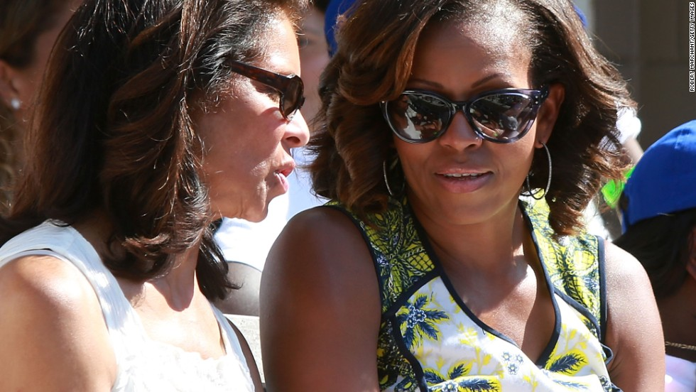 Jeanne Ashe talks with Michelle Obama as the president's wife attended Arthur Ashe Kids' Day at Flushing Meadows earlier this year.