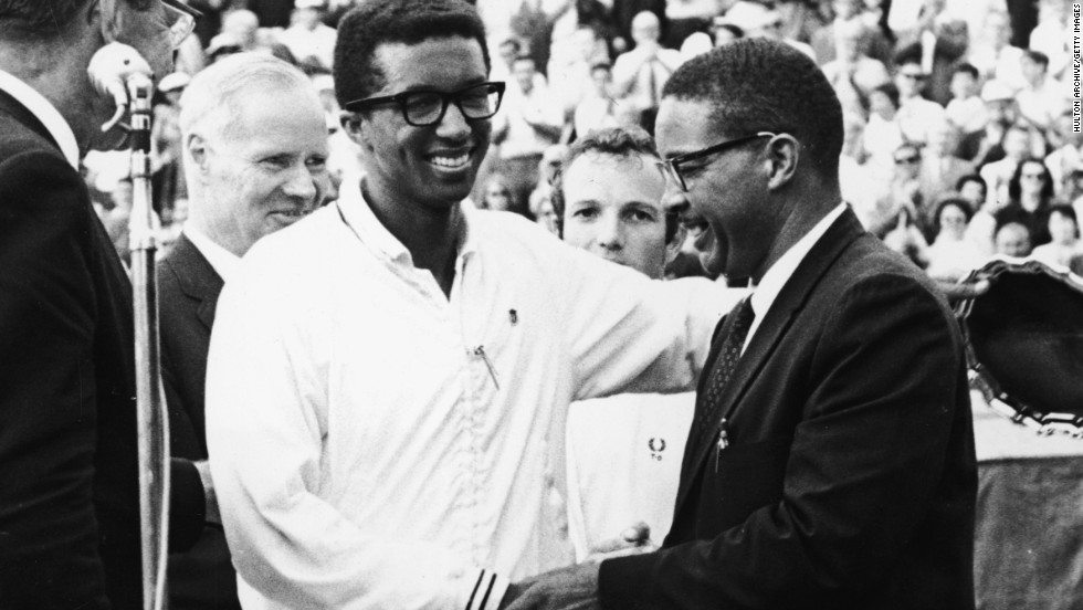 Five years before his win at Wimbledon, Ashe won the U.S. Open  title at Forest Hills in New York. Here he receives the congratulations of his father Arthur Ashe Senior after winning the U.S. grand slam.