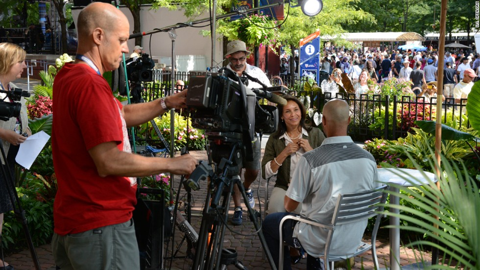 James Blake gets ready to interview Jeanne Ashe for CNN at the 2013 U.S. Open at Flushing Meadows.