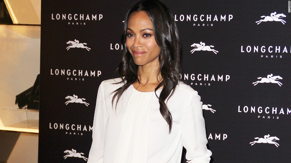 Zoe Saldana shows her gams while attending a Longchamp launch party in London on September 14.