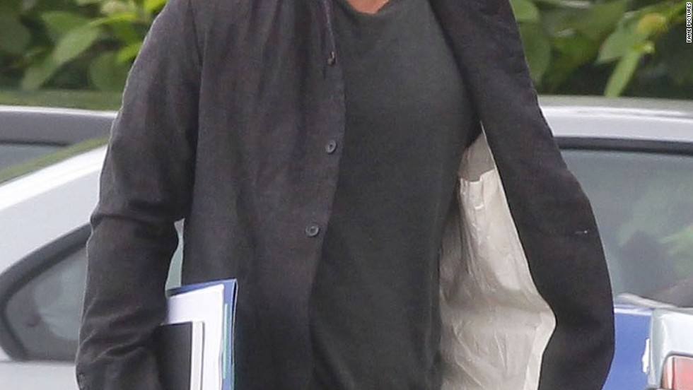 Brad Pitt shows off his shorter hair while filming in the U.K. on September 14.