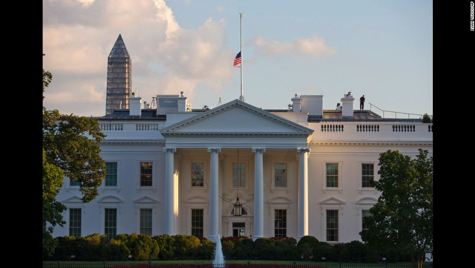 The U.S. flag flies at half-staff above the White House the day of the deadly shooting.