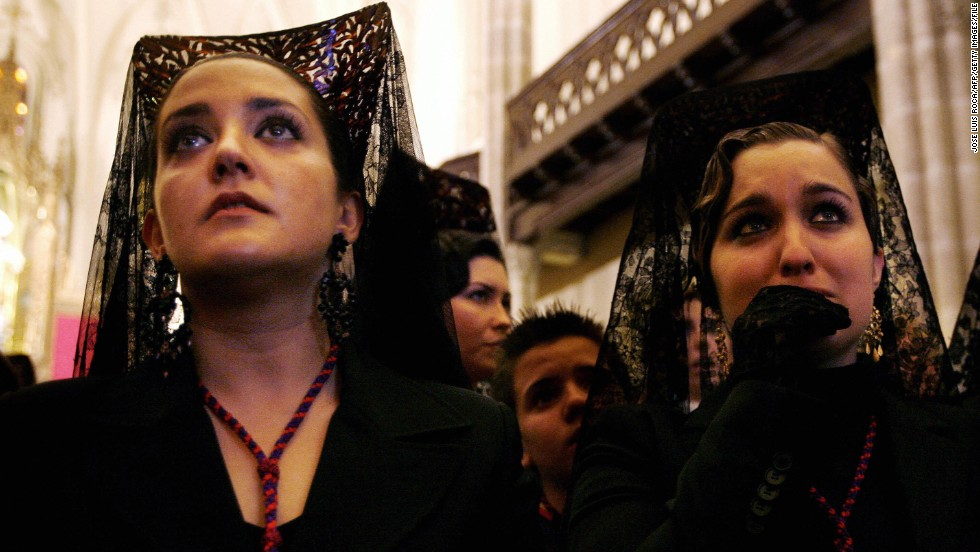 For many, religion remains a powerful part of everyday life in Spain. These women are dressed in traditional mantillas during Holy Week in Granada.
