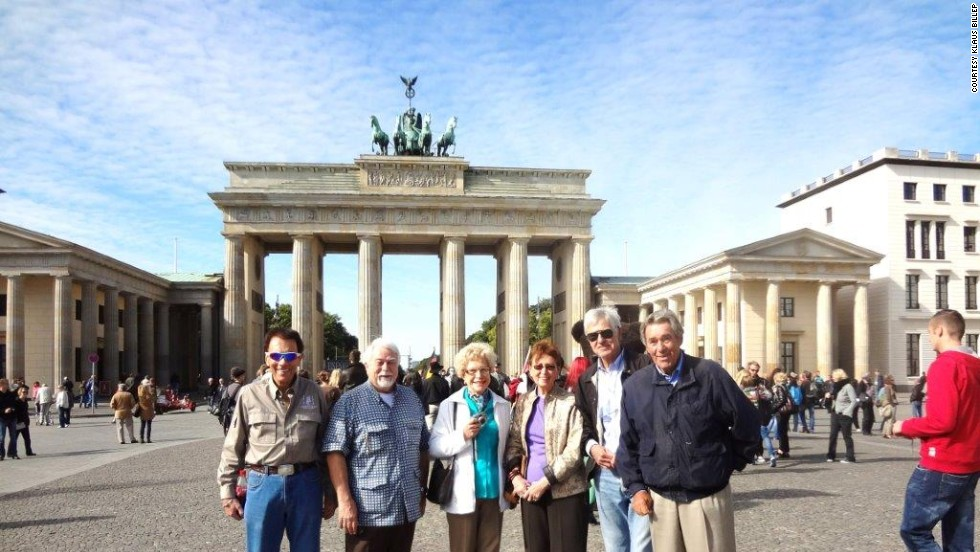 Billep, here at Berlin's Brandenburg Gate, says the club was one of the first places travelers swapped stories and recommendations. Then the Internet changed everything.