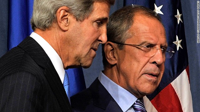 US Secretary of State John Kerry (R) and Russian Foreign Minister Sergey Lavrov arrive for a press conference at the Hotel Intercontinental on September 12, 2013 in Geneva, Switzerland. The leaders met to discuss chemical weapons in Syria in working towards assisting a U.N. Security Council resolution.
