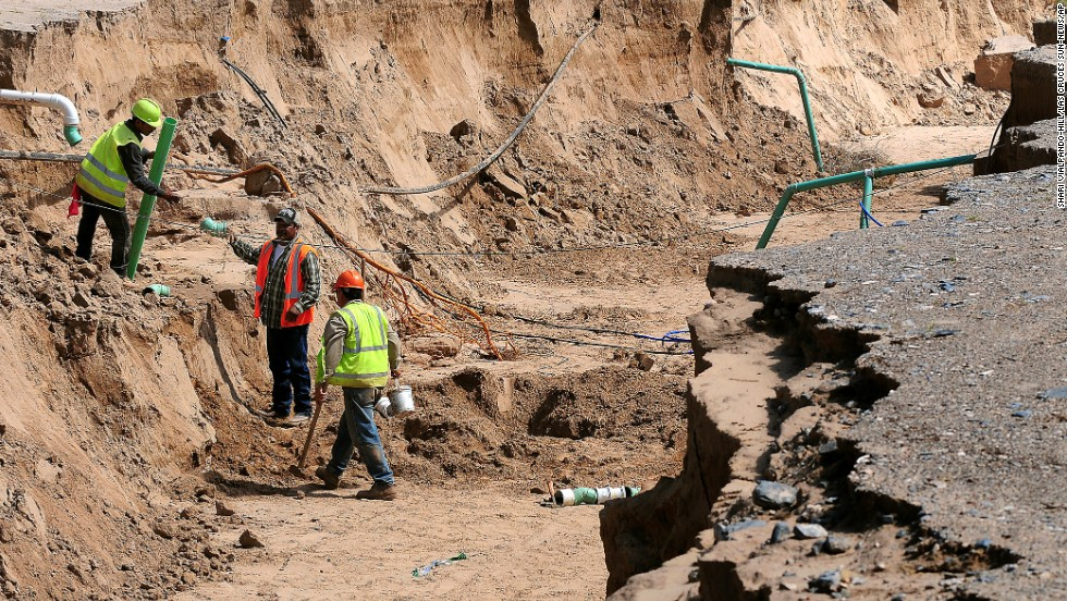 "A construction crew begins work on multiple utility lines in a sinkhole in La Union, New Mexico, on Monday, September 16. Workers estimated the hole to be 13-feet deep and 30-feet wide. New Mexico declared a statewide disaster on September 13 because of widespread flooding. <a href=""http://www.cnn.com/2013/09/12/us/gallery/colorado-flooding/index.html"">View photos of severe flooding in Colorado.</a>"