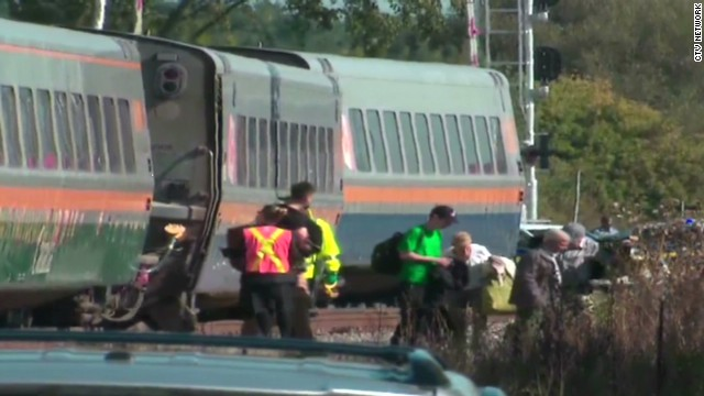 Train collides with double-decker bus