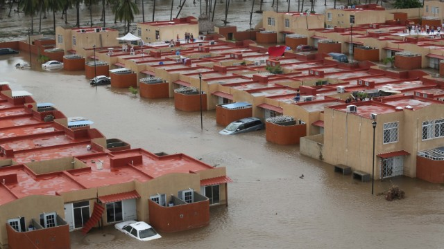 At least 57 dead in Mexico after storms