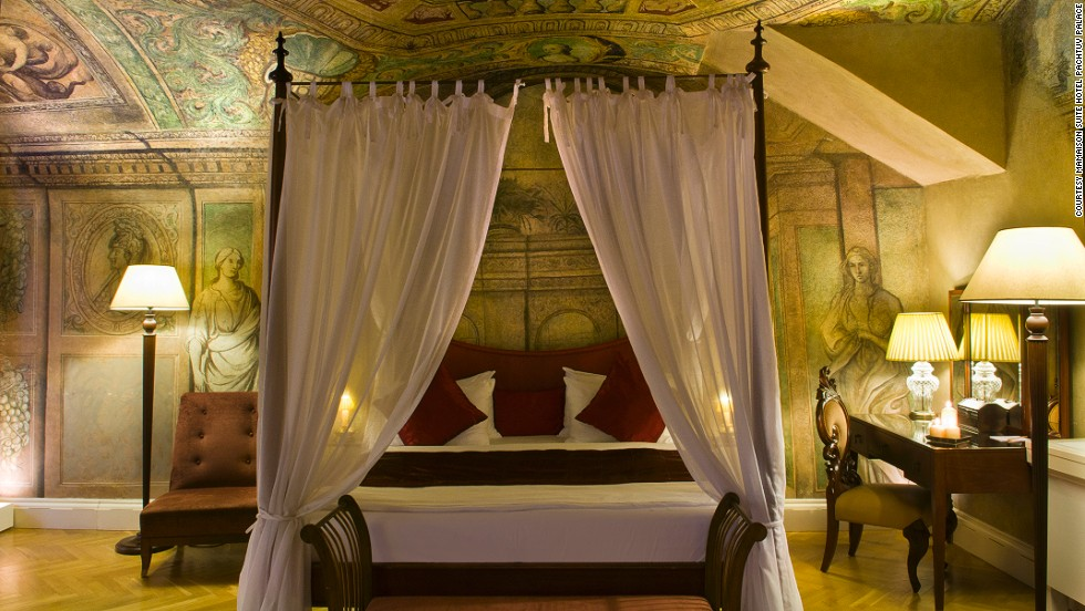 Each of the hotel's 50 suites features frescoes along the ceilings, fireplaces in the corners, and four-poster beds.