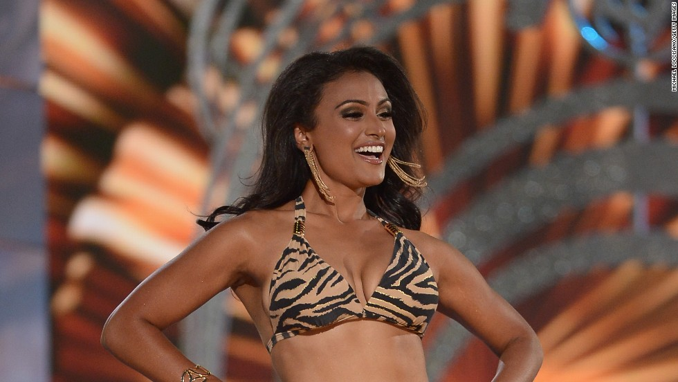 ATLANTIC CITY, NJ - SEPTEMBER 15: Miss America 2014 contestant Miss New York Nina Davuluri performs in the bathing suit portion of the 2014 Miss America Competition at Boardwalk Hall Arena on September 15, 2013 in Atlantic City, New Jersey.