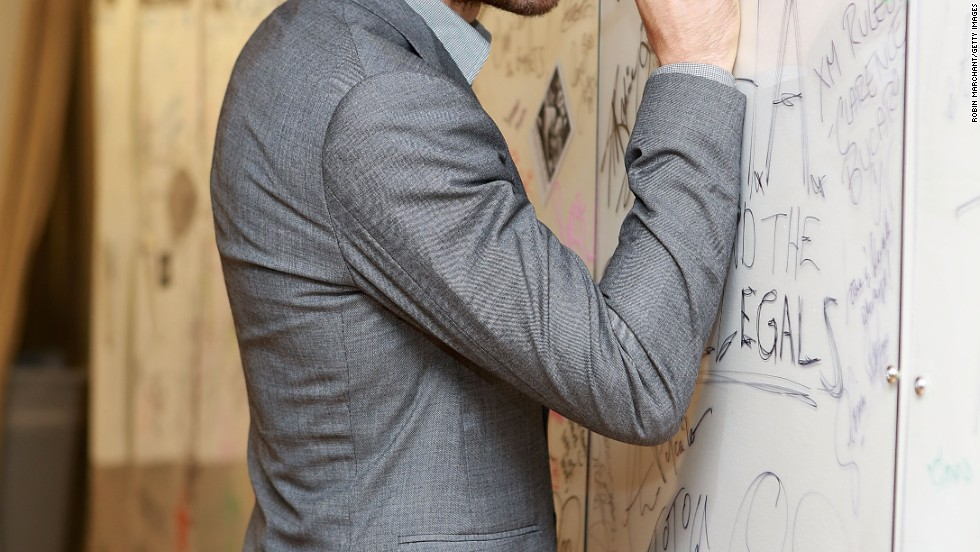 Jake Gyllenhaal signs his name while visiting SiriusXM on September 18.