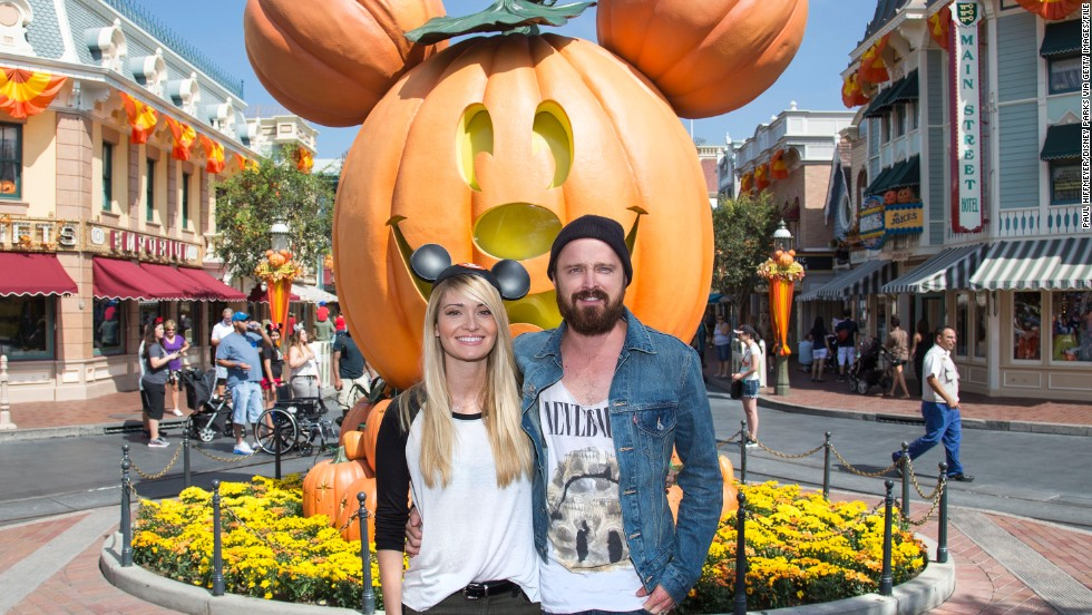 "Aaron Paul and wife Lauren Parsekian enjoy ""Halloween Time"" at Disneyland on September 17."