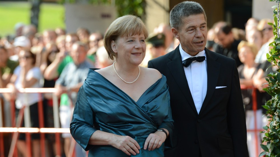 Merkel shares a passion for opera with her camera-shy husband, Joachim Sauer. Here they are pictured arriving for the opening of the Bayreuth Wagner Opera Festival in July 2012.