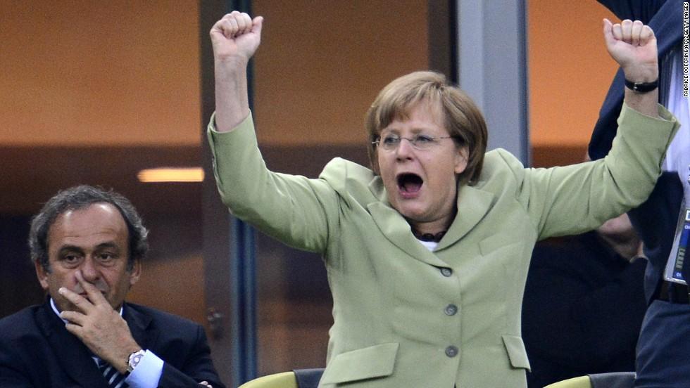 "A big football fan, Merkel celebrates <a href=""http://worldsport.blogs.cnn.com/2013/05/02/9100/"">Germany scoring a goal against Greece</a> during the Euro 2012 football championships quarter-final match in Gdansk ."