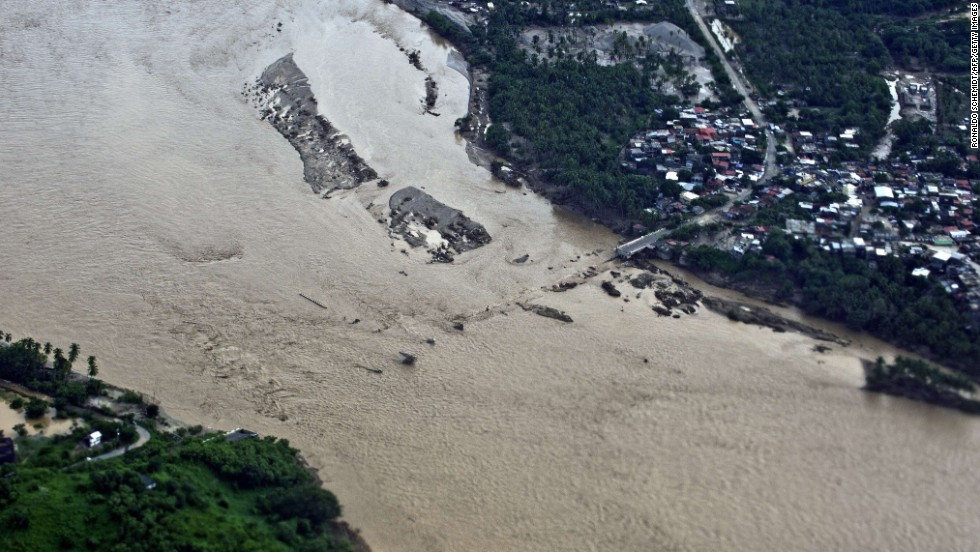 The Papagayo River swells with floodwaters in Acapulco on Tuesday, September 17.