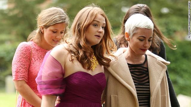 Kathryn Blair (center) leaves All Saints Church on September 14, 2013, in Wotton Underwood, England.