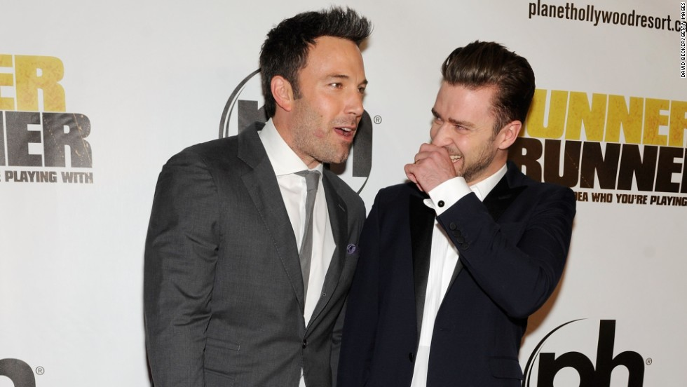 """Runner Runner"" co-stars Ben Affleck and Justin Timberlake share a laugh at the premiere of their movie on September 18."