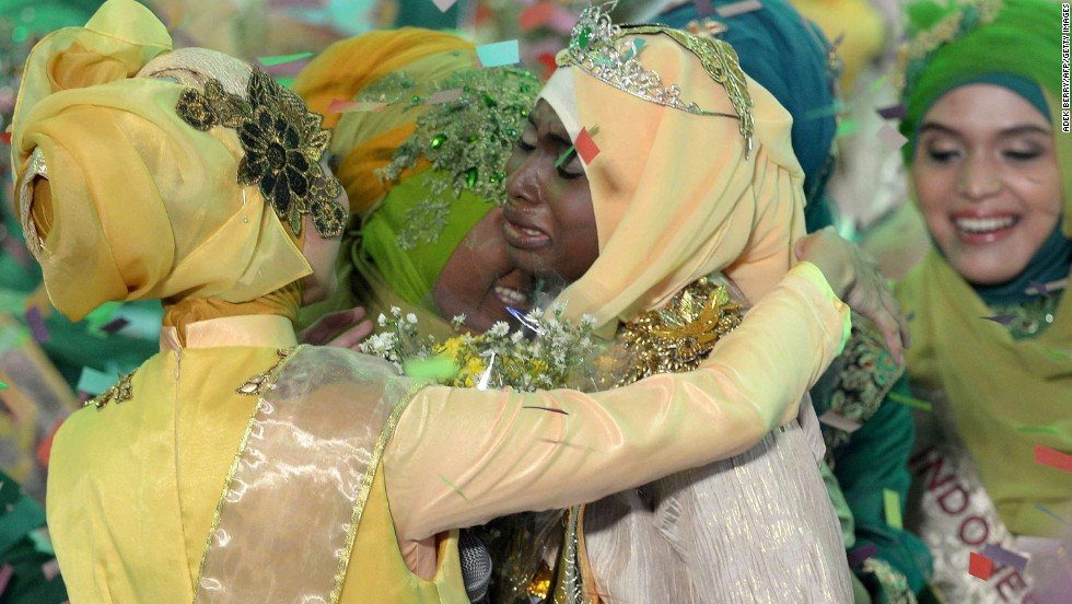 Ajibola is congratulated by contestants after being crowned World Muslimah 2013.