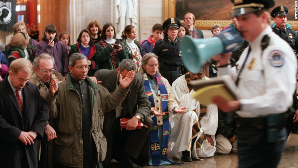A speaks to demonstrators at the Capitol Rotunda on December 7, 1995. Evangelical leaders from around the country held a prayer session to call on legislators to treat the poor justly during welfare reform and budget negotiations.