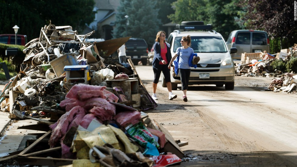 Piles of items destroyed by flooding line both sides of a street in Longmont on September 19.