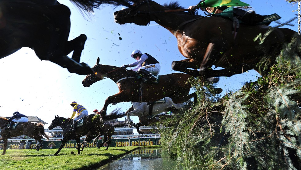 Irish jockey Peter Toole sails over the water jump on Fine Parchment at Aintree in April 2011. His racing career would end the next day after he suffered bleeding on the brain when falling at the first fence in a race preceding the Grand National.