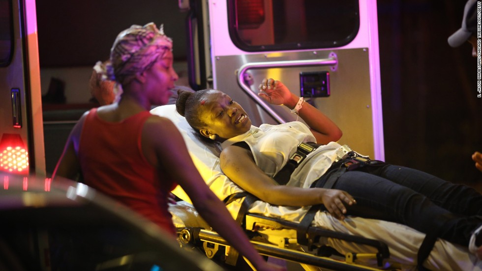 Emergency personnel transport victims from the scene of the shooting on September 19.