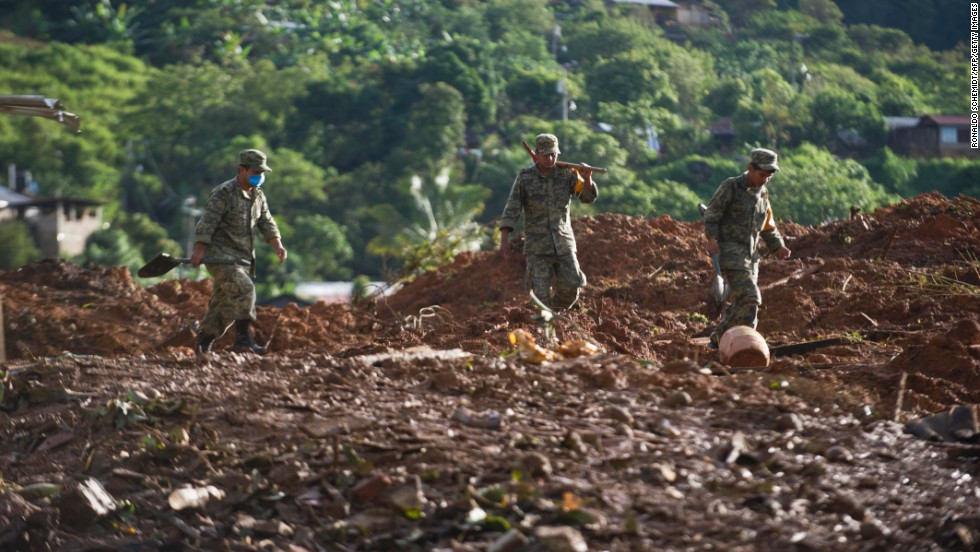 Mexican soldiers search through mud and debris in the state of Guerrero on September 20. Guerrero was the hardest-hit state from the dual onslaught of Hurricane Manuel and sister storm Ingrid.