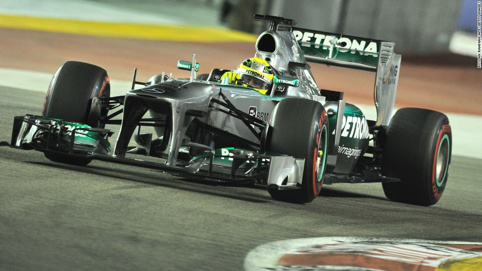 Mercedes driver Nico Rosberg qualified second ahead of Lotus' Romain Grosjean and Vettel's teammate Mark Webber.