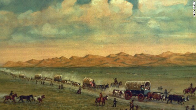 Painting by W.H. Jackson shows pioneers crossing the plains with the Sand Hills of Nebraska's Platte Valley in the background.