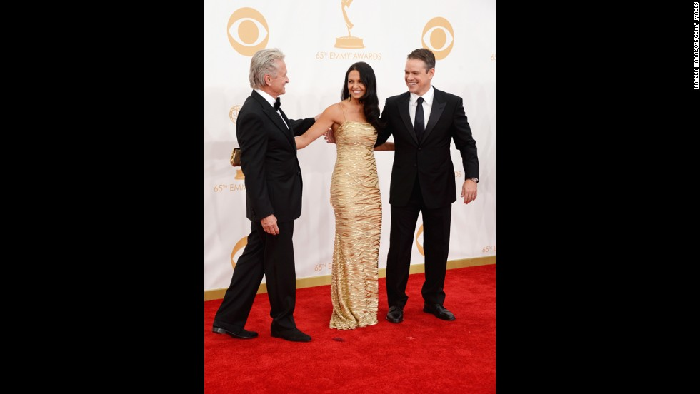 """""""Behind the Candelabra"""" stars Michael Douglas, Matt Damon and Damon's wife, Luciana Barroso. The HBO biopic on Liberace won the Emmy for outstanding miniseries or TV movie, and Douglas received the top actor award in a miniseries or TV movie for his performance as the pianist."""