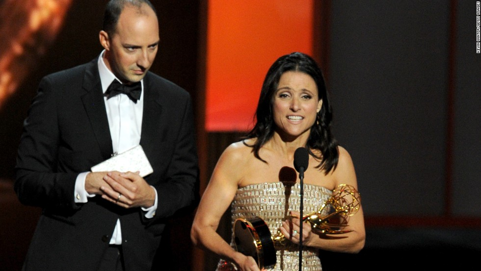 "Julia Louis-Dreyfus accepts the award for outstanding lead actress in a comedy series while ""Veep"" co-star Tony Hale, who won outstanding supporting actor, looks on."