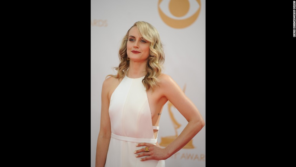 """Orange Is the New Black"" actress Taylor Schilling wears an eye-catching white gown."
