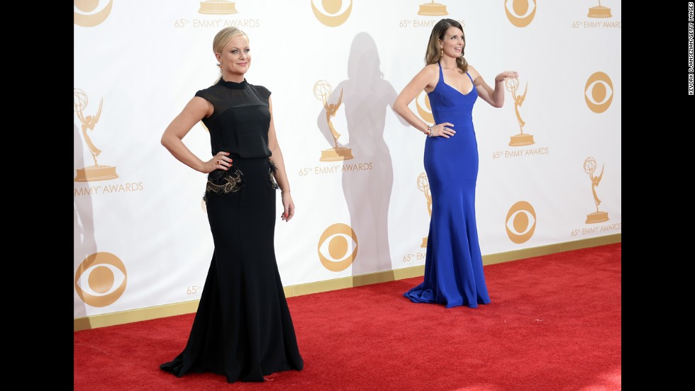 "Amy Poehler, left, with Tina Fey. <a href=""http://www.cnn.com/2013/09/22/showbiz/tv/hosts-neil-patrick-harris-emmys/index.html?hpt=en_c2"" target=""_blank"">The two added a little extra levity to Emmy host Neil Patrick Harris' opening number.</a>"