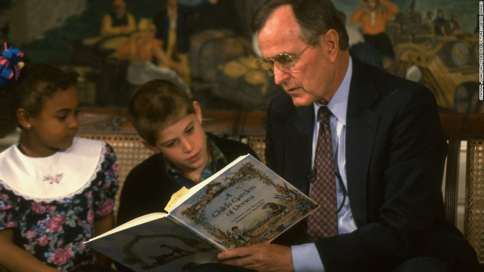 "President George H.W. Bush reads ""A Child's Garden of Verses"" at Zachary Taylor Elementary School, in Arlington, Virginia, in 1991."