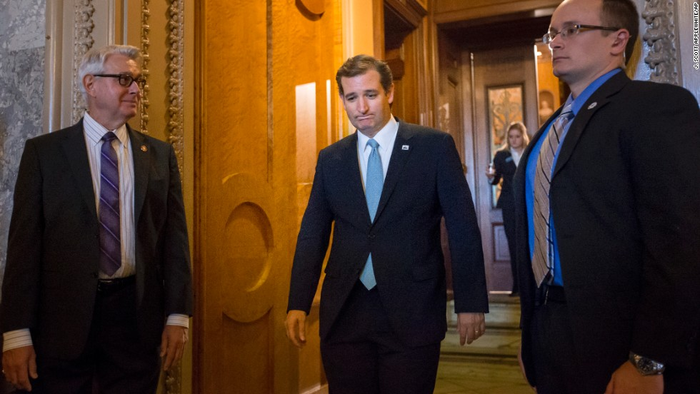 Cruz emerges from the Senate chamber after spending more than 21 hours railing against  Obamacare in September 2013.