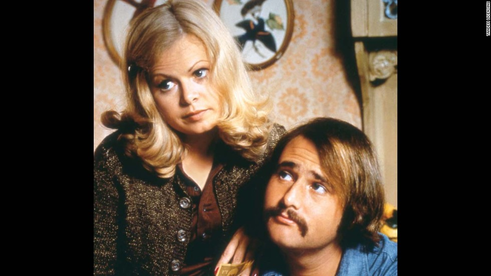 "On the 1970s sitcom ""All in the Family,"" couple Gloria and Mike, played by Sally Struthers and Rob Reiner, were forced by finances to live with Gloria's parents, Archie and Edith Bunker. Archie and Mike often clashed over political differences."