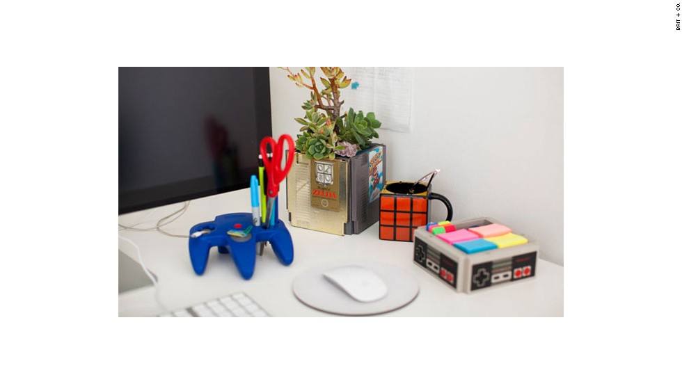 Brit + Co. production manager Misty Spinney created a Nintendo-themed desk, complete with a planter made of classic Nintendo games and a phone charger wired through an N64 controller.
