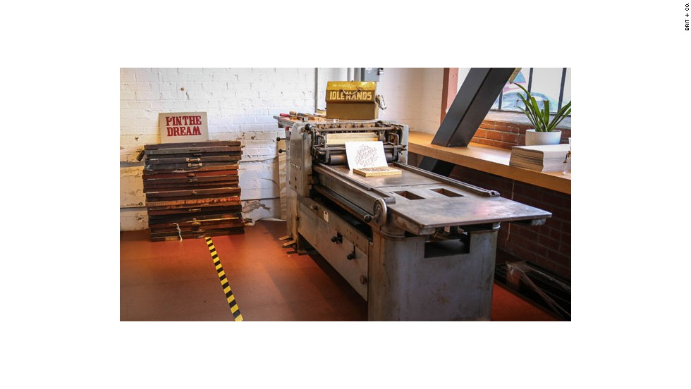 Pinterest brand manager Everett Katigbak brought in a printing press to help employees spruce up their open office work space with letterpress signs.