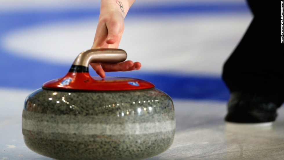 The curling stone is made of Scottish granite and slid along the ice, usually with one to three rotations in its trajectory to curve it past what are known as guarding stones as teams battle for position.