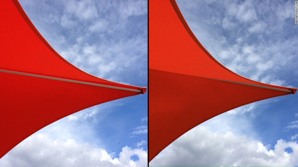 The red color of this awning and the blue of the sky look richer and more saturated in the iPhone 5S picture on the right.
