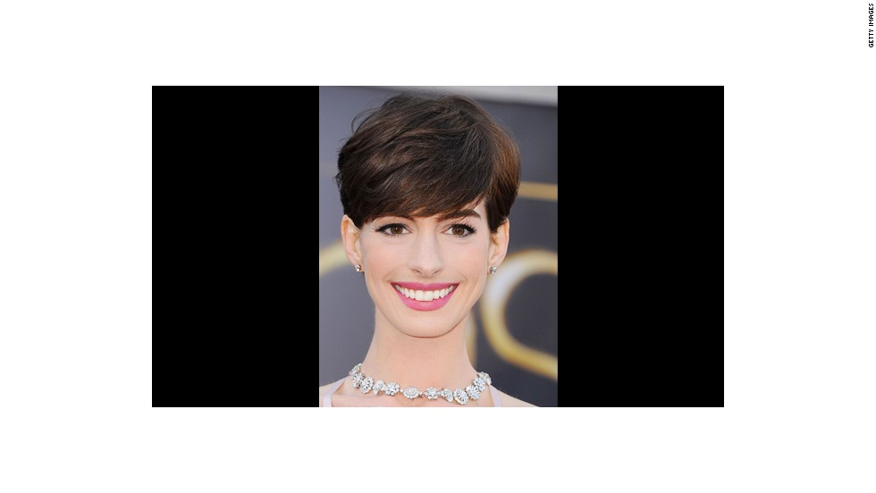 Anne Hathaway's carnation pink lips and subtly defined eyes are perfect for a daytime wedding says makeup artist Kate Lee.