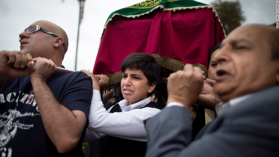 Relatives carry a coffin Wednesday, September 25, during a funeral procession for Selima Merali and her daughter Nuriana Merali, who were killed by gunmen in the attack at the Westgate Shopping Mall in Nairobi, Kenya.