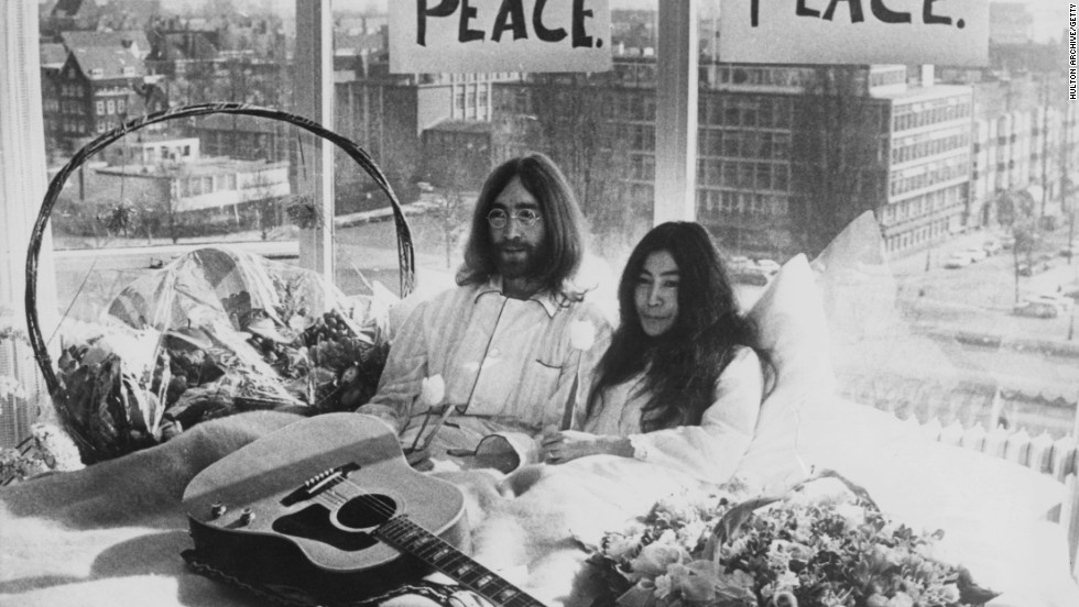 "John and Yoko held their legendary ""bed-in"" at the Hilton Amsterdam. He wrote ""Imagine"" at a Hilton in New York. Was it the in-room TVs (a Hilton first) or the natty stationery that drew him to the hotels?"