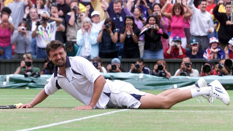 An emotional Goran Ivanisevic hit the floor after becoming the first wildcard entry to win Wimbledon in 2001. The Croatian came into the final after a five-set semifinal against Tim Henman. He had to call on physical and mental reserves to beat Pat Rafter to the trophy in another seesaw five-set epic.