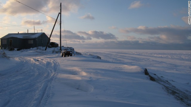 Shelton Kokeok, whose home is shown in November 2009, lives on the edge of the world in Shishmaref, Alaska.