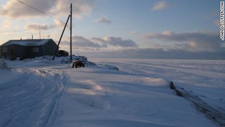 Shelton Kokeok, whose home is shown in November 2009, lives on the edge of the world in Shishmaref, Alaska.