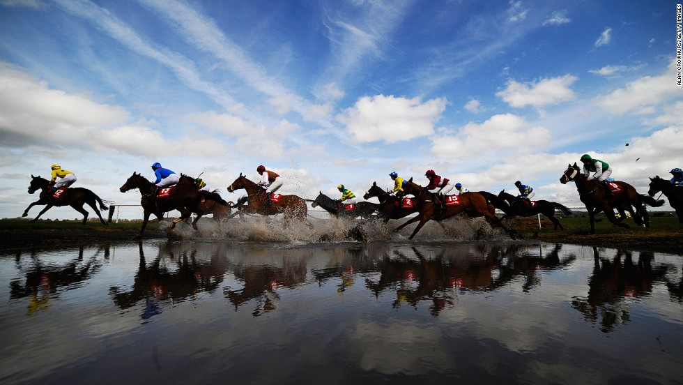 "<strong>Punchestown, Ireland: </strong>Runners make their way through ""Joe's Water Splash'""at Punchestown racecourse in April."
