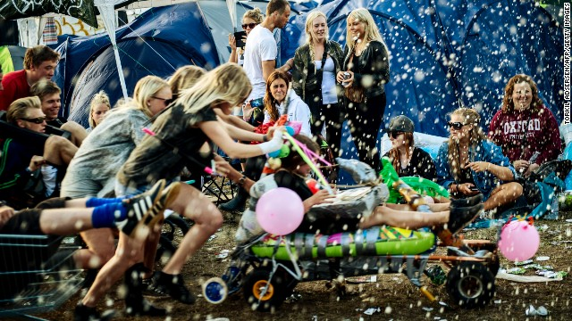 Life isn't always a party in Denmark, but people are happy anyway, like these at the Roskilde festival.