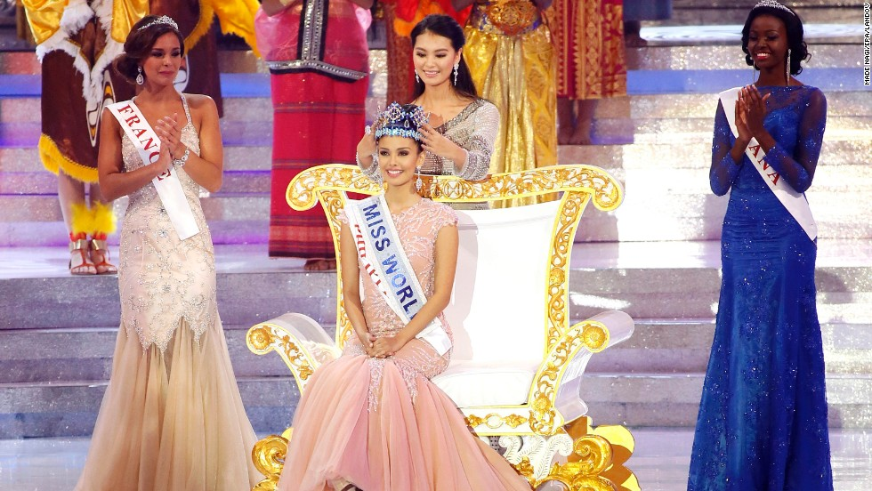 "Miss World 2012, Yu Wenxia crowns Megan Young of the Philippines as the new Miss World during the grand finale of the Miss World 2013 beauty pageant held at Bali Nusa Dua in Bali, Indonesia, on Saturday, September 28. ""No words! Thank you so much for everyone for choosing me,"" said Young. ""I promise to be the best Miss World ever."" Miss France Marine Lorphelin, left, took second and Miss Ghana Carranzar Naa Okailey Shooter, took third."
