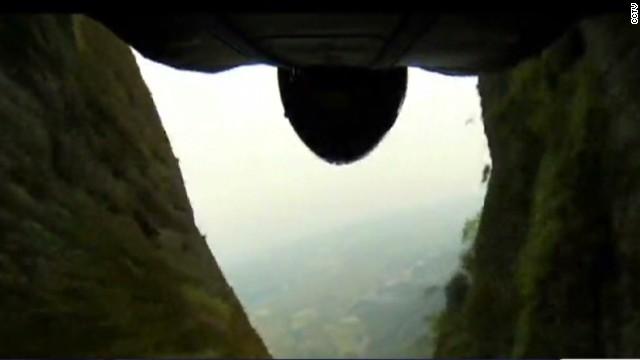 Wingsuit pilot flies into narrow valley